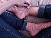 Image of Lyne Socks by Dawn Henderson modeled on feet, image copyright Dawn Henderson