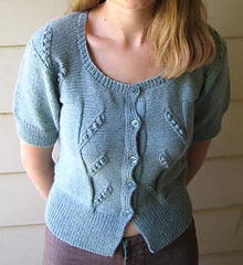Image of a woman wearing the Pea Pod Cardigan by Mel Clark, image copyright Mel Clark