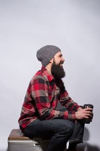 Image of a male model wearing the Rist Canyon Beanie by Meghan Huber, image copyright Knitscene