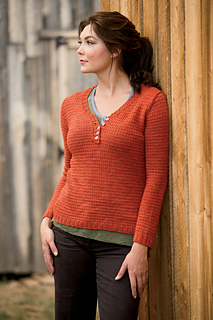 Image of a model wearing the Vercheres Pullover by Heather Zoppetti, image copyright Interweave Knits