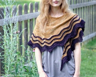 Image of Carina Spencer wearing her Whipporwill shawl in a garden, image copyright Carina Spencer